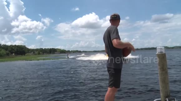 Man catches American football while doing a backflip on a wakeboard