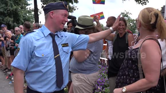 Swedish police officer dances during Pride Festival in Stockholm