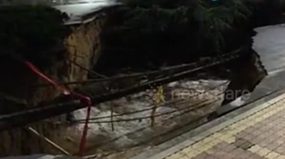 Sinkhole opens up in the middle of the road in China