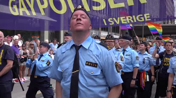 POLIC OFFICER DANCES WITH GAY POLICES