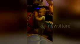 Newsflare - Newsflare Edit - Baby 'rocks out' to heavy metal