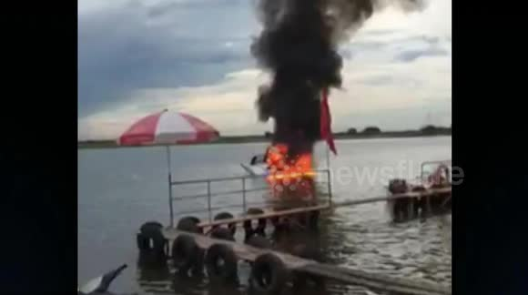 Helicopter crashes into river