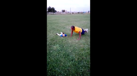 Funny baby trying to make push-up