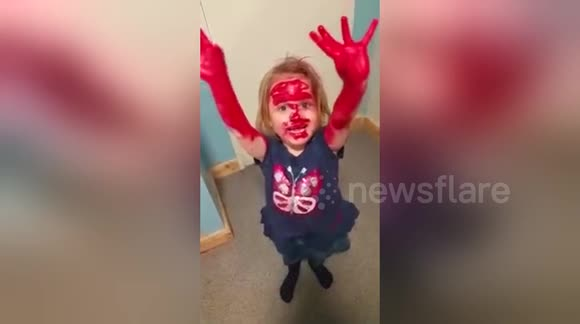Little girl covers herself in lipstick to 'look like Spiderman'