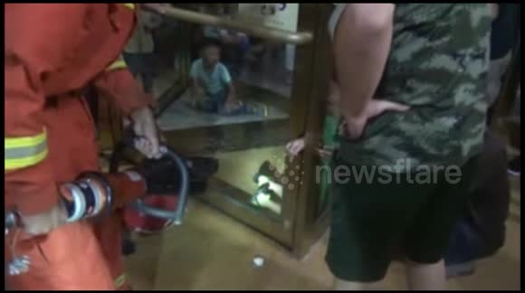 Firefighters rescue boy with arm stuck in revolving door