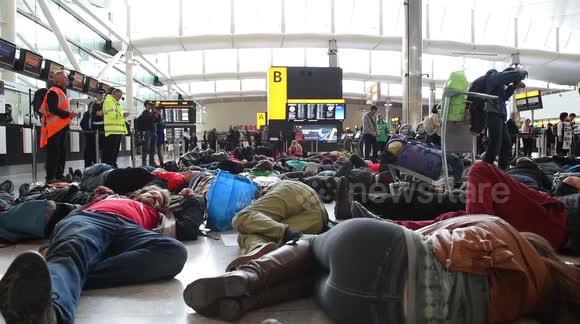 Protesters stage 'die-in' at London Heathrow airport