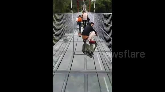Chinese tourists get really scared walking on glass bridge