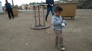 Child in refugee migrant camp in France