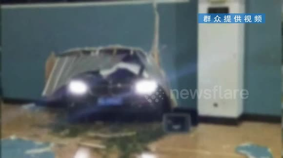 BMW crashes through stadium wall, narrowly missing basketball player