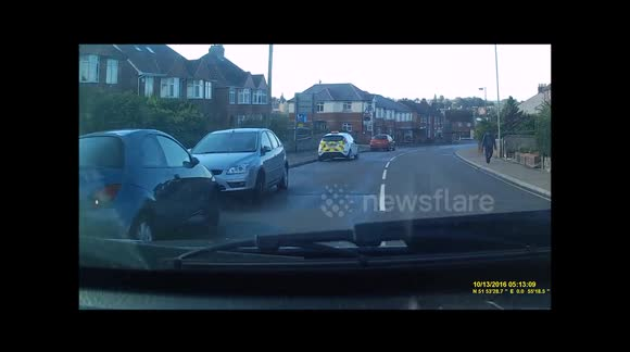 Car on wrong side of road narrowly avoids head-on collision