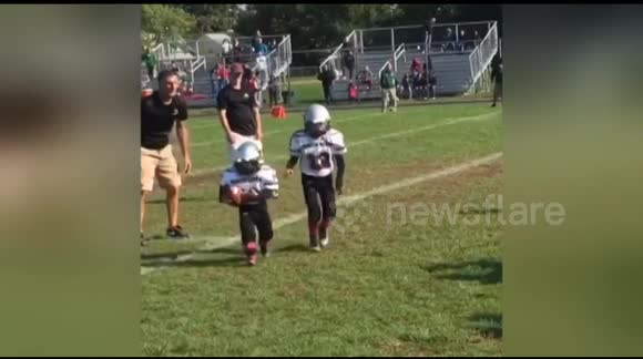 Twins, 6, with Down syndrome score touchdown in American football game