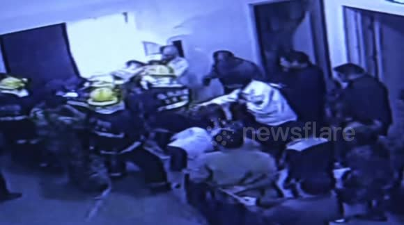 Two workers on tricycle break through elevator door and fall down shaft