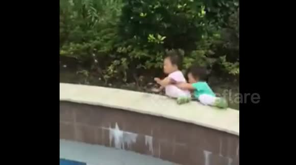 Twins fall down at exactly the same time