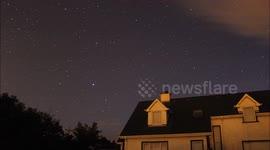 Newsflare - bright Iridium satellite flare illuminates cloud