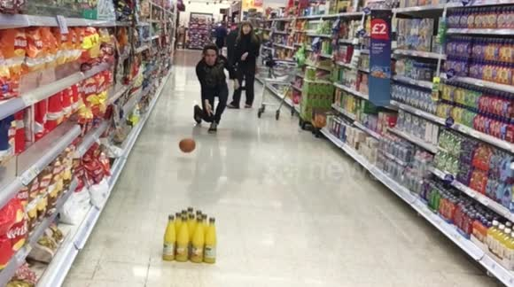 YouTuber plays 'pumpkin bowling' in supermarket
