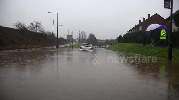 Flooding Caused By Heavy Rain Has Risen To Chest Hight Submerging Cars
