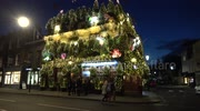 London pub installs 21,000 lights and 90 Christmas Trees and it looks awesome