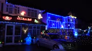 Residents decorate London street in festive lights for charity