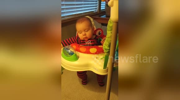 Baby fights sleep to keep jumping longer