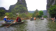 Tam Coc, Vietnam - Girls row boats with their feet