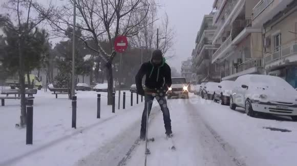 Man skis though city streets in Thessaloniki, Greece