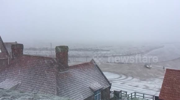 Wind and snow arrive in Blakeney, Norfolk.