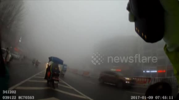 Police officers send girl to school after she losing the way in heavy fog
