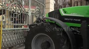 Greek farmers take the streets and block government building with tractors